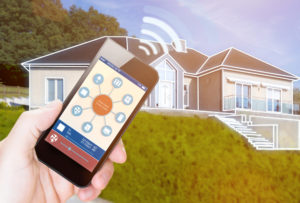 A remote app on a cell phone sending signal to a house to control the temperature