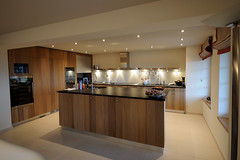 A modern kitchen with an island and wooden cabinets