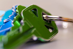 Green and blue tinted keys on a key ring